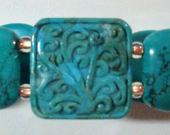Bracelet:  Carved Composite Turquoise Square Focal Bead, Turquoise-Dyed Howlite Rounded Rectangle Beads, & Bronze-Lined Czech Glass Beads