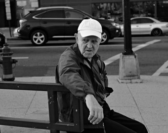 Street Photograph of a Man who is Grumpy in Washington DC