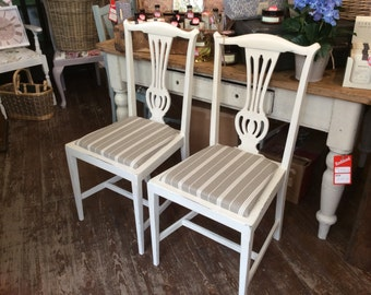 A set of four dining chairs