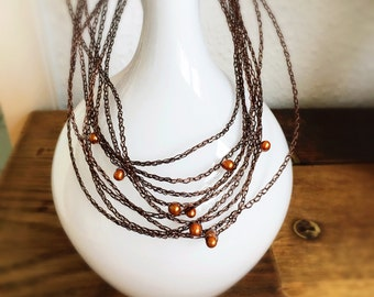 Knitted wire necklace with freshwater pearls