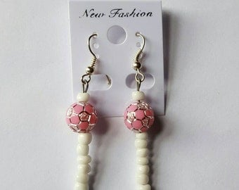 White beaded earrings with a touch of silvered pink ball