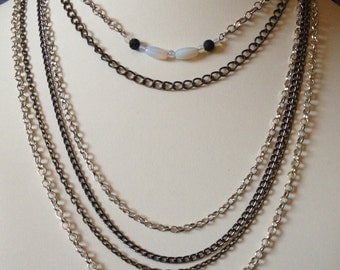 Multiple chain necklace w/meoonstones & lava rocks