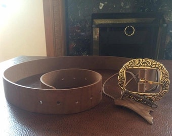 Unique brown belt with gold flowery buckle