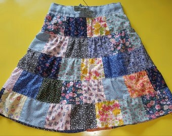 Girls size 6 ruffled 5-tier random patchy skirt