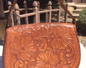 Carved leather cross body bag