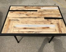 Handcrafted reclaimed barn wood table top with cedar trim and Early American table legs.  A modern feel with a touch of Midwest!