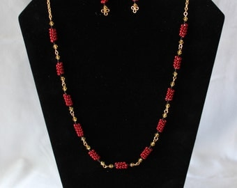 A Stunning Coiled Wire Necklace with Matching Earrings, using Red and Black Wire, a Yellow Bead and Gold Chain.