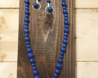 Blue fossil beads with pink center piece