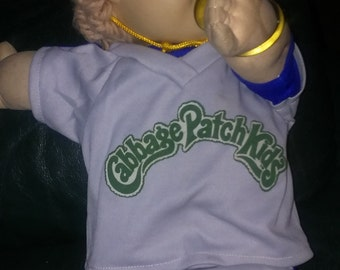 Vintage 1985 cabbage patch doll...boy..blue eyes...pacifier...baseball outfit and shoes....has original papers