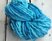 Bulky thick and thin hand dyed wool yarn. Super bulky shades of blue, sunny seas, soft yarn.