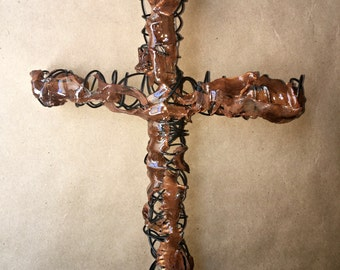 Wire cross with brown painted plexiglass