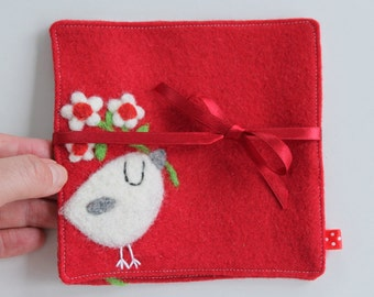 Set of two red wool fabric coasters with needle felted white flowers and birdie bird