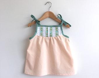 SALE! SIZE 2T only: girls pale peach cotton sun top with vintage floral trim detail