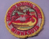 vintage patch Superior National Forest Minnesota embroidered 2 5/8 in wide, round Native American motif design canoeing camping retro Used