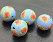Set of Four Round Shaped Polymer Clay Artisan Made Beads in Light Periwinkle Blue With Spiral Millefiore Beading and Jewelry Supplies