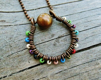 Wire Wrapped Seed Bead Circle Necklace of antiqued copper and blue tones seed beads