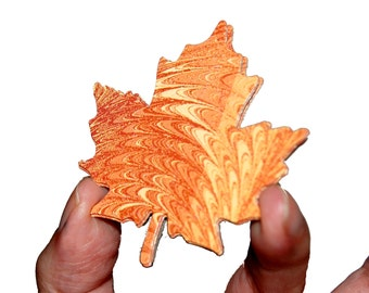 Maple Leaf Cut-outs with Swirled Orange and Yellow Surface