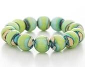 blue lime bracelet, glass, silver, stretch style, artisan lampwork jewelry
