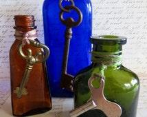 Three Colored Glass Bottles with Skeleton Keys, Vintage Bottles
