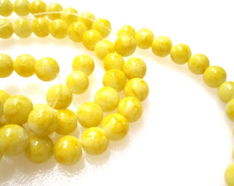 1 Strand of 8mm Yellow veined with terracotta glass beads, 32 inches approx 109 beads. GBW 114