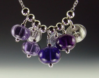 Purple Passion-Hollow Lampwork Bead necklace, 7 beads on 18 inch silver plated chain