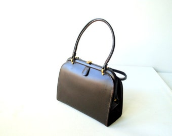Classy vintage 60s dark chocolate brown, patent  leather, Kelly style , small hand bag. Made by Coblentz original.