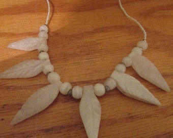 Stone carved willow leaf chocker