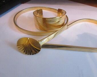 snake gold belt and cuff