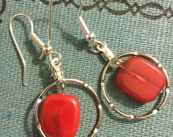 Red rectangle and silver earrings