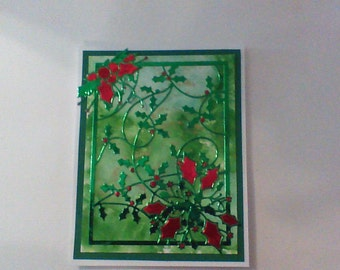 Christmas easel card with holly in red,white and green.