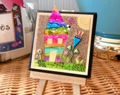 """Original Mixed-media Microbead Collage on 3"""" x 3"""" canvas, wonky house and graden, with wooden easel for display"""