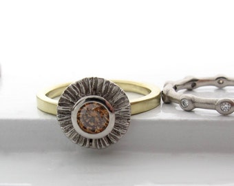 Ruffled 950 palladium and 18kt green gold ring with a .50ct cognac diamond