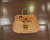 Nice vintage wicker fishing creel with hinged lid, leather strap closure and wood hanger