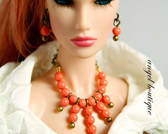 Collar Necklace Dangling with Orange Swarovski Pearl. Set Completes with Matching Earrings.