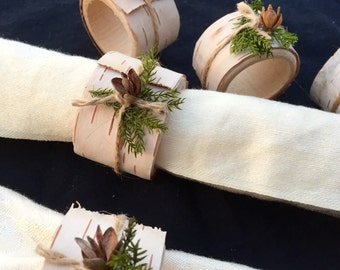 Set of 6 Birch bark covered wooden napkin rings with preserved pine, jute and pine cones.