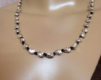 Silver nugget necklace- knotted nuggets on black cord toggle clasp