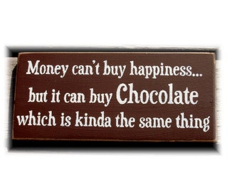 Money can't buy happiness but it can buy chocolate... wood sign