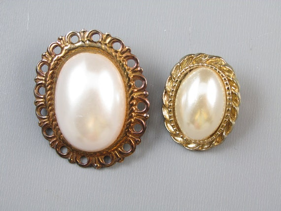 Pair of vintage gold tone faux mabe pearl brooch pins