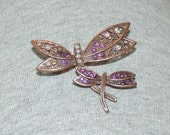 Dragonfly brooch or pin, copper color metal with rhinestone accents, lavender, purple, rainbow or iridescent stones