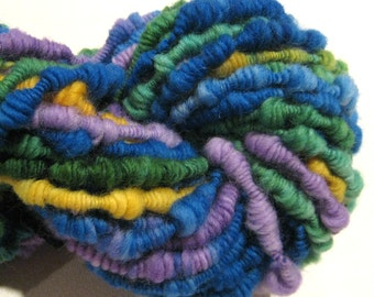 Handspun yarn Jumpin Jack supercoil  bulky art yarn 37 yards purple blue green yellow knitting supplies crochet supplies Waldorf doll hair