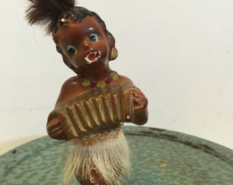 BLACK AMERICANA FIGURINE Island Boy with Squeeze Box and Grass Skirt at A Vintage Revolution