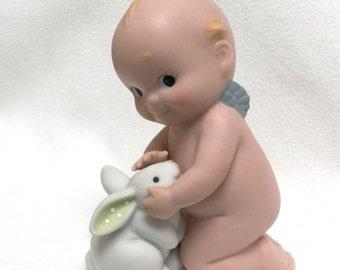 Enesco Kewpie Kneeling and  Petting a Bunny