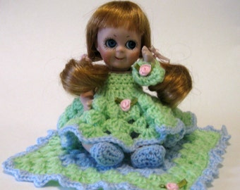 "Googlie 5"" doll cast from a vintage mold in porcelain dressed in a crocheted dress"