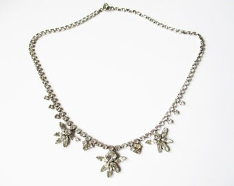 Rhinestone statement necklace: Glorious 1950s silver tone and princess cut rhinestone statement costume necklace, rhinestone flower necklace