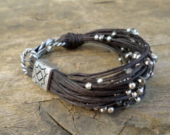 Cord bracelet, brown beaded bracelet with silver beads and crystals, multistring beaded bracelet, beaded jewelry handcraft in Italy