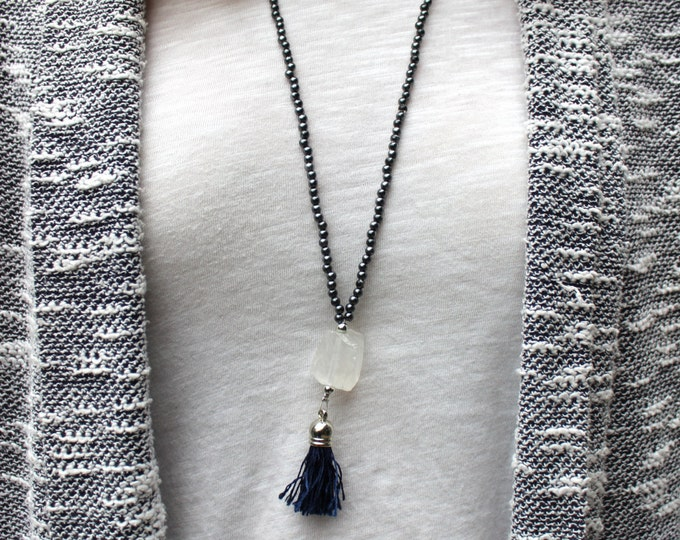 Raw quartz beaded tassel necklace in gunmetal grey.