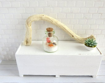 Terrarium bottle with seascape in shades of red in 1:12 scale