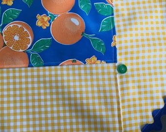 The Floridian---Retro two patterned round oilcloth tablecloth with juicy oranges