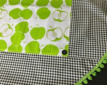 An apple for the teacher---green apple and black gingham oilcloth tablecloth