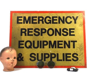 vintage 60s 70s metal sign EMS emergency response equipment supplies yellow black industrial rectangular wall hanging home decor decorative